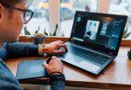 man editing photos on laptop
